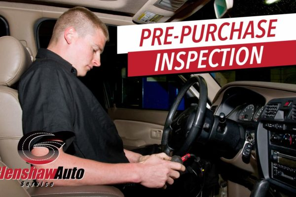 glens haw auto technician inspecting car