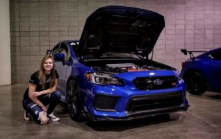 Picture of Kylie and her Subaru