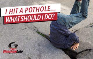 Man stuck in pothole