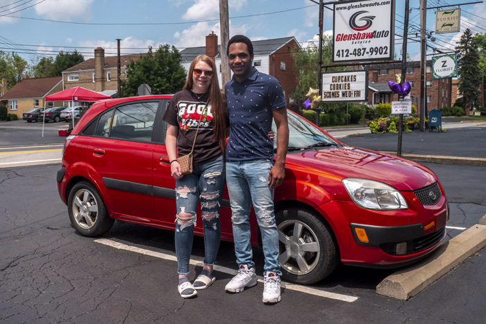 Photo of two people in front of a car for the Next Step Auto Initiative