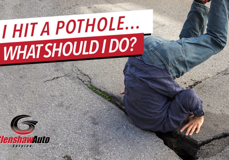 Man stuck in pothole